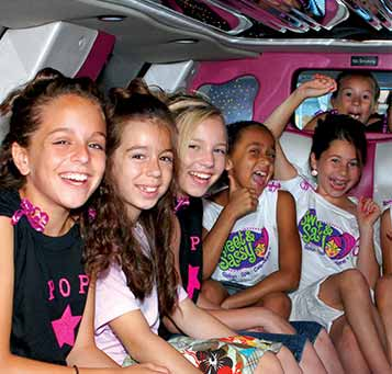 Kids having fun in a limo