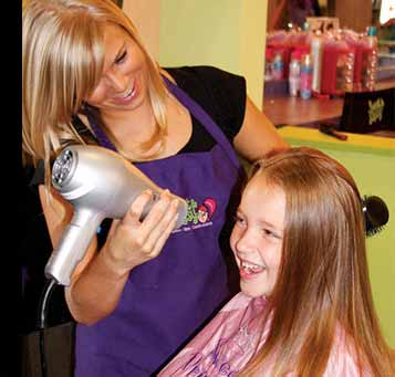 Girl getting her hair blow dried