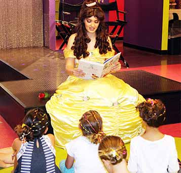 Princess reading book to kids